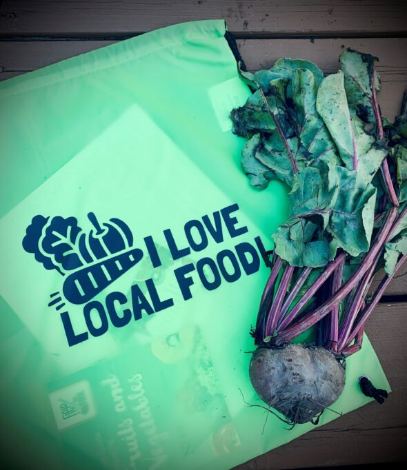 bag with logo 'i love local food' on it, along with a red beet