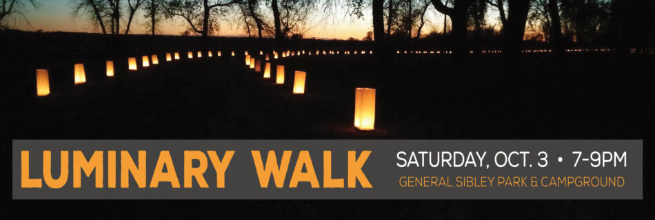 Luminary Walk, outdoor path at night, light with candles along the edge